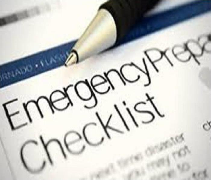 An image of a pen and an Emergency Preparedness Checklist