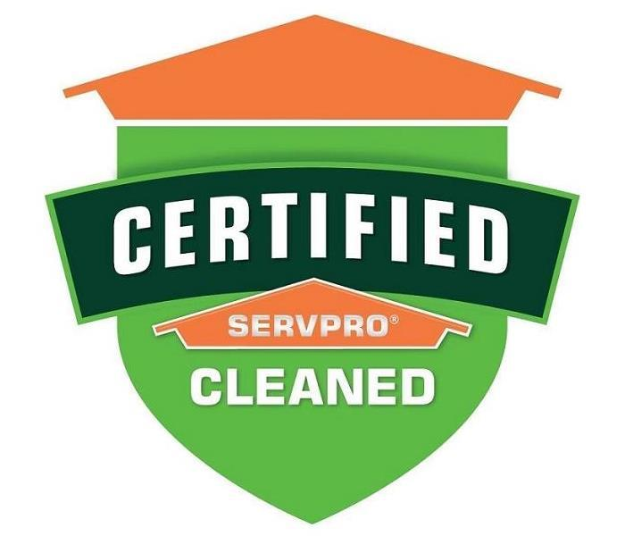 An image of an orange and green shield bearing the words Certified: SERVPRO Cleaned